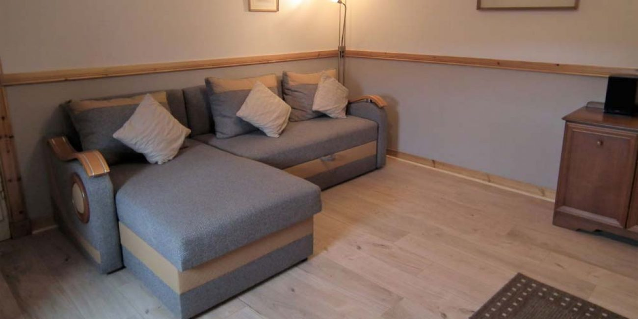Inchnadamph-Estate-Glenbain-Dining-Living-Room-with-Sofa-Bed